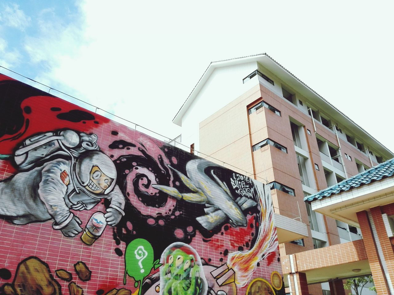 art and craft, architecture, low angle view, building exterior, built structure, creativity, outdoors, day, no people, multi colored, sky, sculpture, dragon, chinese dragon