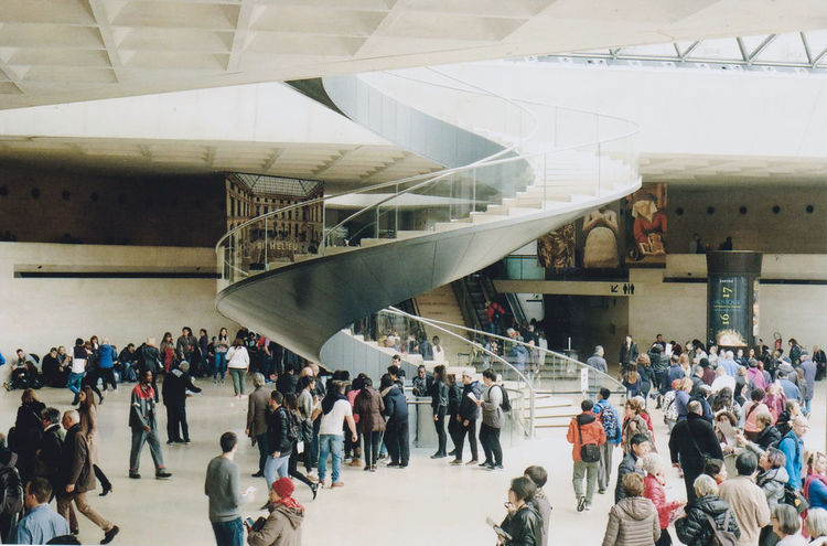 Spiral. Louvre Paris Spiral Staircase Spiral Stairs Architectural Column Architecture Bridge - Man Made Structure Built Structure Crowd Day High Angle View Indoors  Interior Design Large Group Of People Leisure Activity Lifestyles Men People Real People Spiral Travel Travel Destinations Warm Colors Women