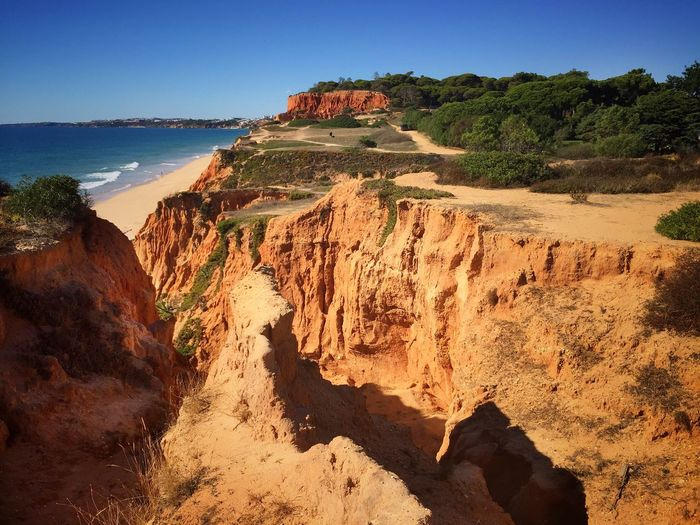 Rock Formation Rock - Object Cliff Nature Beauty In Nature Scenics Tranquil Scene Tranquility Landscape Outdoors No People Day Clear Sky Sunlight Physical Geography Travel Destinations Mountain Sky No Filter No Edit/no Filter Algarve Portugal Beach Nature Waterfront The Traveler - 2018 EyeEm Awards
