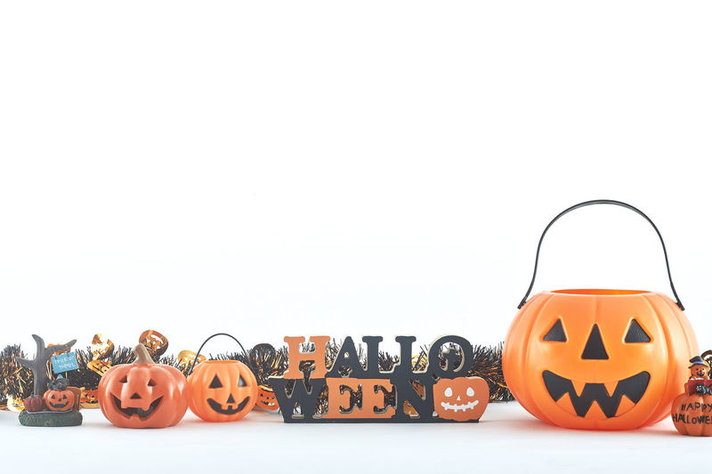 Close-up of halloween decorations against white background