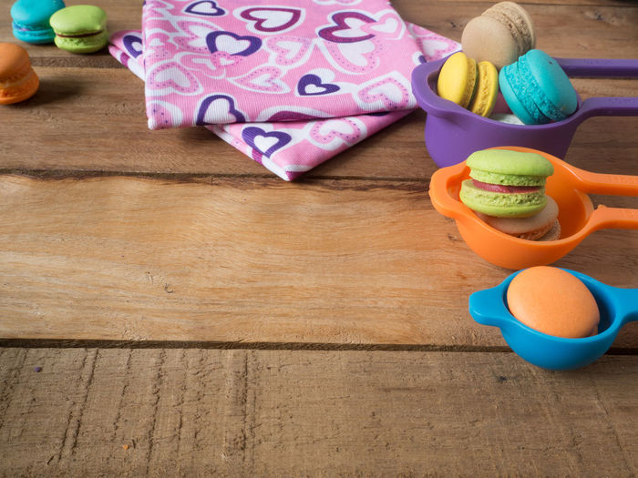 Close-up of colorful macaroons on table