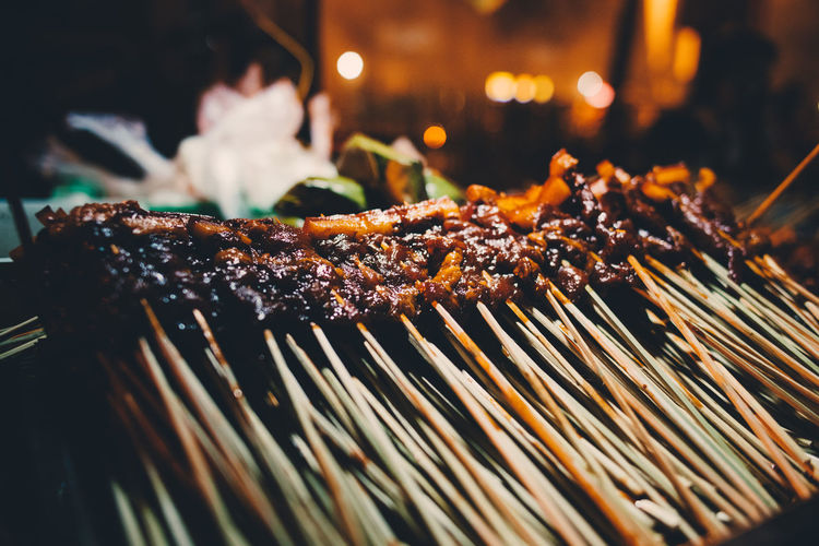 Barbecue Barbecue Grill Burning Close-up Focus On Foreground Food Food And Drink Freshness Grilled Heat - Temperature Indoors  Meat Night No People Ready-to-eat Rib Satay Selective Focus Skewer Smoke - Physical Structure Still Life Street Food Temptation