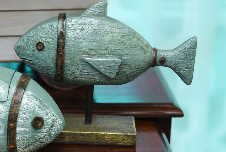 Fish-shaped decorations Architecture Close-up Day Design Door Entrance Focus On Foreground Indoors  Latch Lock Metal No People Old Protection Rusty Safety Security Still Life Wood - Material
