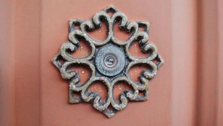 Close-up of peephole on wooden door