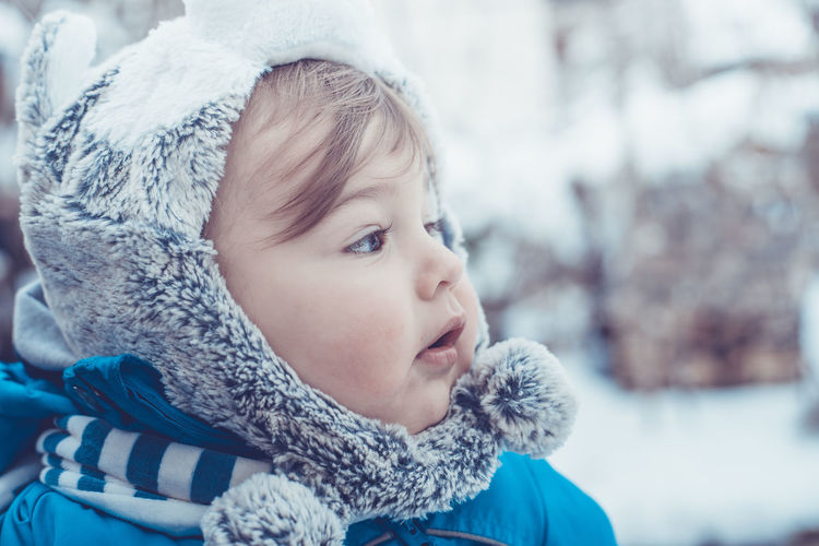 Baby Boy Blue Winter Cold Temperature Warm Clothing Snow Childhood Knit Hat Real People Focus On Foreground Innocence Cute One Person Headshot Close-up Day Scarf Outdoors Leisure Activity Nature Snowflake People