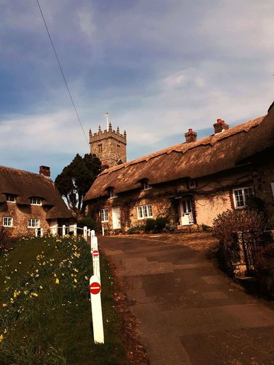 EyeEm Selects Beautiful Old Buildings Godshill Isle Of Wight  Church Village Daffodils Blue Skys Lightly Clouded Spring Time Beautiful Destination Past Present And Future Steep Hill Sky