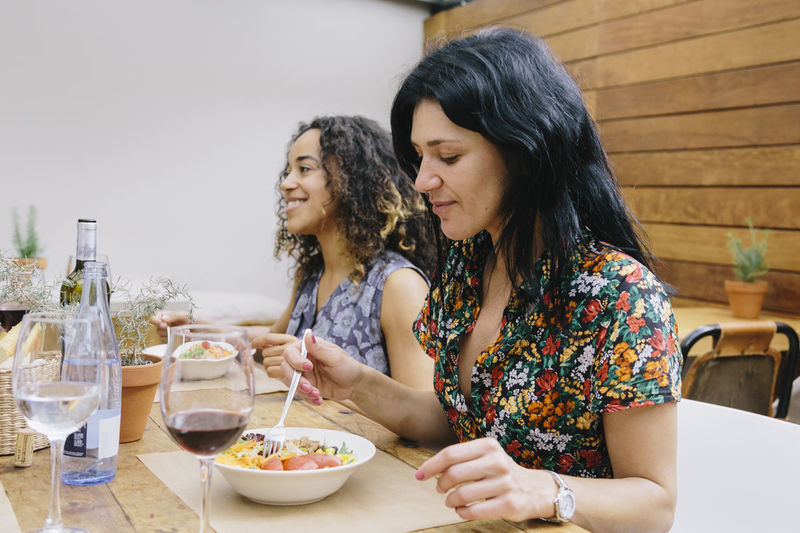 Young Female Friends Having Food At Restaurant