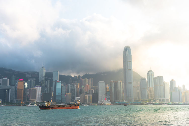 Panorama of skyscraper buildings Landmark at Victoria harbor in Hong Kong Architecture ASIA Asian  Bay Beautiful Boat Building Business China Chinese City Cityscape Colorful Commercial District Downtown Evening Finance Financial Harbor Harbour Hong Hong Kong HongKong Illuminated Island Kong Kowloon Landmark Laser Light Lights Modern Night Panorama Sailboat Scene Scenery Sea Show Sky Skyline Skyscraper Symphony Tourist Tower Travel Victoria View Water