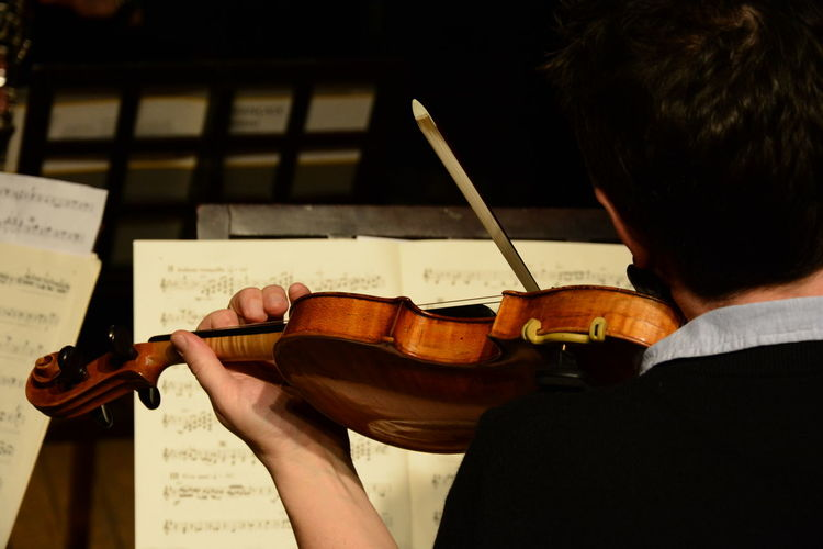 Classical musician playing the Violin and reading music notes Behind Capture The Moment Classical Classical Music Hand Image Instrument Live Live Music Male Music Musician MusicNotes Notes Performance Performer  Performing Photo Photography Photooftheday Photos Stock Stockphoto Violin Violinist