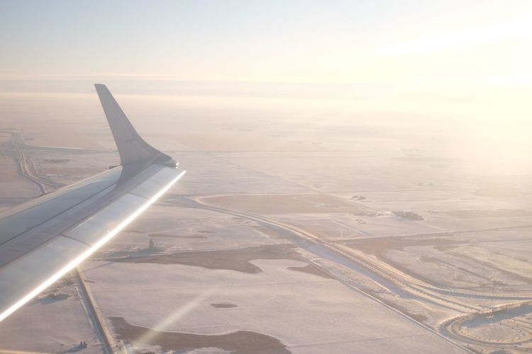 Snow in the prairies Airplane Aerial View Landscape Transportation Scenics Airplane Wing Aircraft Wing Sky No People Travel Journey Flying Day