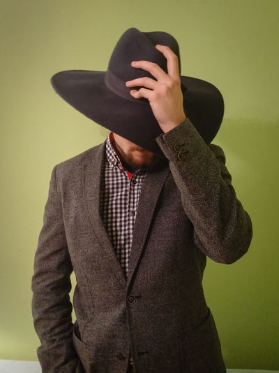 Portrait Of Man Wearing Cowboy Hat