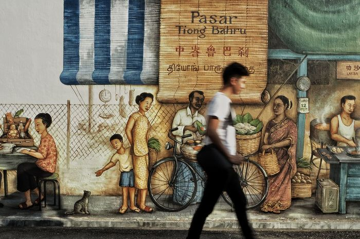 Wall murals and street photography. Full Length Lifestyles Real People Built Structure Men Day Adult Young Adult Mural Mural Art Wall Mural Singapore Tiong Bahru Street Photography The Street Photographer - 2017 EyeEm Awards