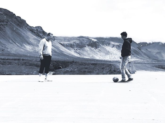 Wonderful Football in the Mountains - PhotoShoot Two People Outdoors Activity Sport Landscape Nature Mountain Adventure Friendship Clear Sky Iceland Mountains Photoshop ArtWork Standing Football Filter
