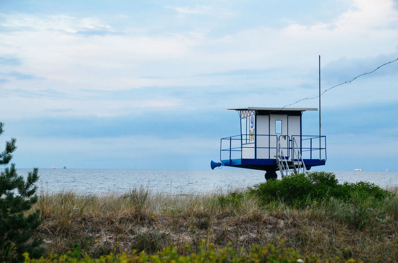 Lifeguard Hut By Baltic Sea Against Cloudy Sky