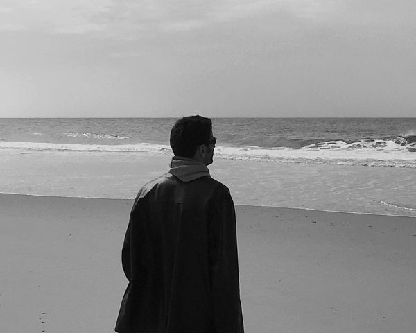 The Man in Black / L'homme en noir People Man People Photography Peoplephotography Beach Open Edit Black And White Blackandwhite Lonely Contemplating