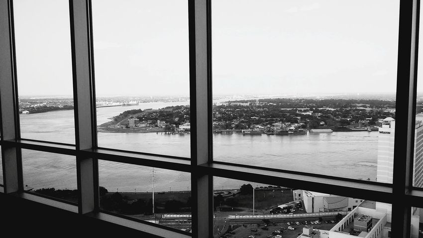 Welcome To Black Window Looking Through Window Cityscape City Indoors  Apartment Day Sky Water No People Domestic Life Domestic Room Sliding Door Urban Skyline Close-up Skyscraper The Great Outdoors - 2017 EyeEm Awards The Architect - 2017 EyeEm Awards