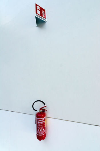 fire extinguisher Fire Fire Extinguisher Safety Red Wall Wall - Building Feature Emergency Equipment Security Copy Space Protection White Extinguishing Fire Alarm Indoors  Single Object Sign Icon