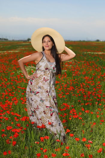 It is a nice sunny Sunday... so we decided to go off town 🌞🌻 Outdoor Photography WeekOnEyeEm EyeEmSelect Flower Young Women Portrait Smiling Rural Scene Women Beautiful Woman Beauty Looking At Camera Red Poppy Wildflower Blooming Sun Hat