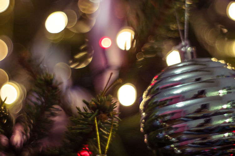 Christmas Holiday Decoration Celebration Christmas Decoration Illuminated christmas tree Christmas Ornament Tree Christmas Lights Lighting Equipment Night Indoors  Holiday - Event Close-up Celebration Event No People Glowing Religion Lens Flare Light