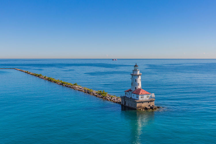 Lighthouse Chicago Water Sea Sky Horizon Over Water Blue Horizon Built Structure Scenics - Nature Guidance Beauty In Nature Architecture Clear Sky Tower Lighthouse Waterfront Nature No People Day Copy Space Outdoors Groyne
