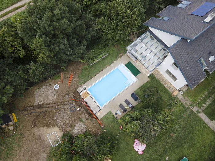 High angle view of swimming pool by building in city