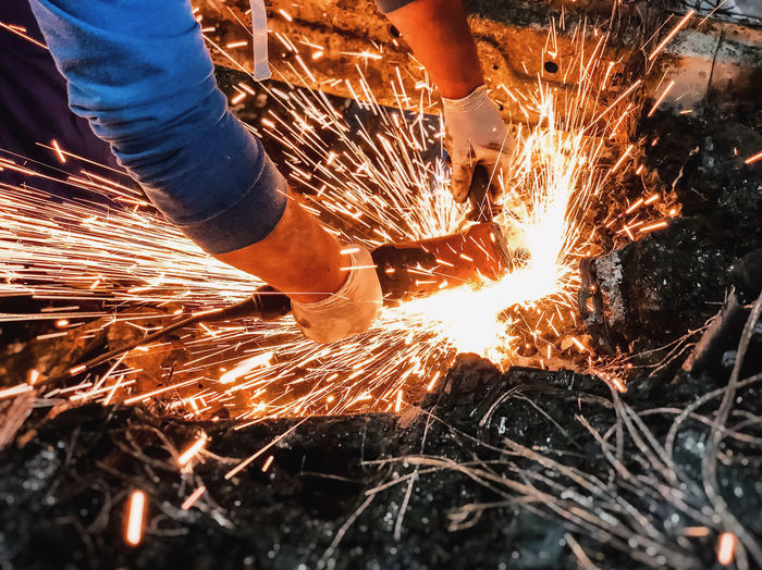 Low angle view of man working on fire