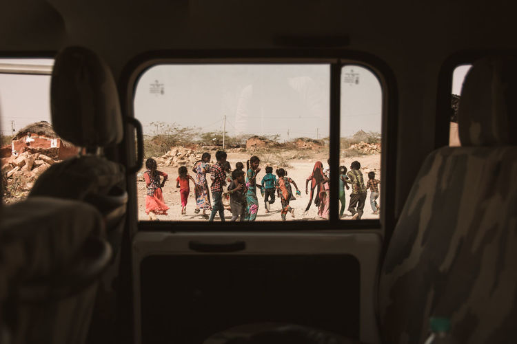 When the kids in a gypsy village drove us , the travellers out of their village ... Poverty Window Travel Exploring Jaisalmer Arid Climate Arid Landscape Desert Rajasthan Gypsy Kids Traveling Car Point Of View Perspective Frame Social Issues Streetphotography Angry Intense Hostile Environment Drought Barren Tourism Car Interior Vehicle The Photojournalist - 2019 EyeEm Awards The Traveler - 2019 EyeEm Awards