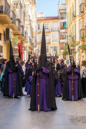 People in the procession in the Holy Week (Semana Santa) in a Spanish city. Malaga, Spain - March 26, 2018. Catolic Church Children Easter Easter Ready Historical Building Holy Week Malaga People Watching SPAIN Semana Santa Spanish Uniform Uniforms Architecture Building Building Exterior Built Structure Catolicism Celebration City Clothing Crowd Day España Festival Group Of People Large Group Of People Men Musical Instrument Musician Musician Bands Old Buildings Outdoors Procession Real People Religion Sabor Spain Is Different Spanish Arquitecture Spanish Culture Street Traditional Clothing Uniform Women The Street Photographer - 2018 EyeEm Awards The Traveler - 2018 EyeEm Awards