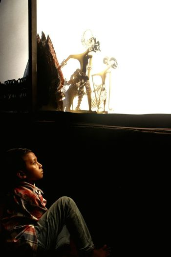 A child learning about life lesson through Wayang Kulit show. Children Only Childhood Javanese Tradition Javanese Culture Traditional Art Traditional Culture Arts Culture And Entertainment Wayangkulit Wayangindonesia Wayang Art Human Interest Streetphotography Street Light One Boy Only People Child Sitting Indonesia Heritage Art Outdoors
