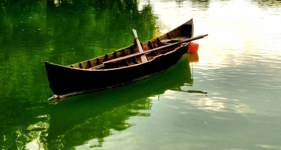 Lonely boat Waterfront Lake Water Reflection Day Nature Green Color No People Tranquil Scene Tranquility Tineretuluipark Bucharest Romania Fresh On Eyeem  TakeoverContrast