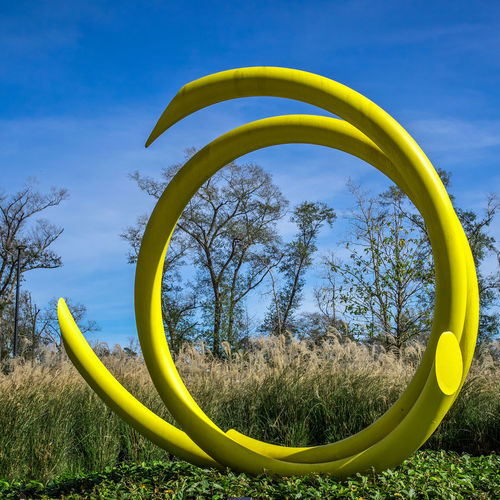 Pipe Art Work in Yellow Art Beauty In Nature Blue Day Green Green Color Nature No People Outdoors Pattern Sculpture Sky The Woodlands Texas Tree Yellow