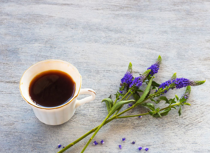 Drink Freshness Flower Table Cup Flowering Plant Plant Food And Drink Refreshment Mug Nature Close-up Tea No People Hot Drink Wood - Material Still Life Purple Beauty In Nature Coffee Outdoors Tea Cup Non-alcoholic Beverage