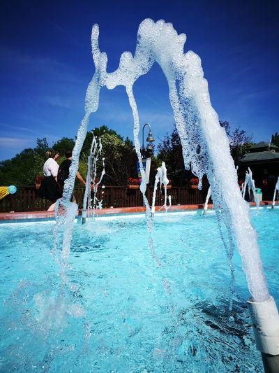 Water Splashing Fountain Spraying Real People Water Slide Outdoors Day Fun Motion