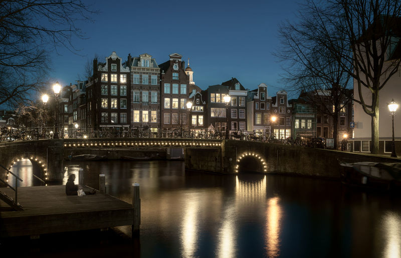 Remo SCarfo Amsterdam Holland Dutch EyeEmNewHere EyeEm Best Shots Tadaa Community EyeEm Gallery The Netherlands Winter Happy People 2019 Architecture Built Structure Building Exterior Water Illuminated Bridge Sky Tree Bridge - Man Made Structure Connection City Reflection River Nature Night Bare Tree Dusk Street Light No People Outdoors Arch Bridge