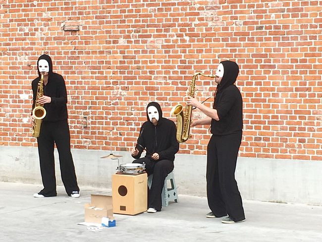 Play some music Streetphotography Streetmusician Saxophone Mask Trio Black Clothes Sphere Music