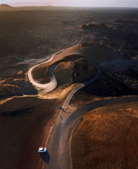 Aerial view of winding road amidst landscape