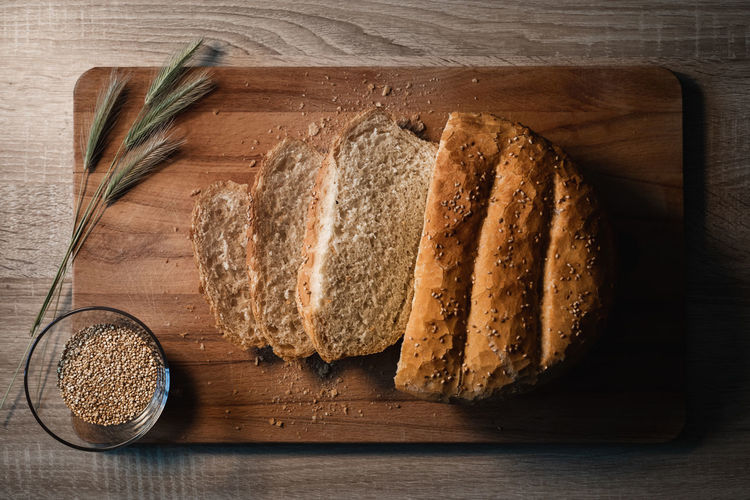 High angle view of bread on cutting board