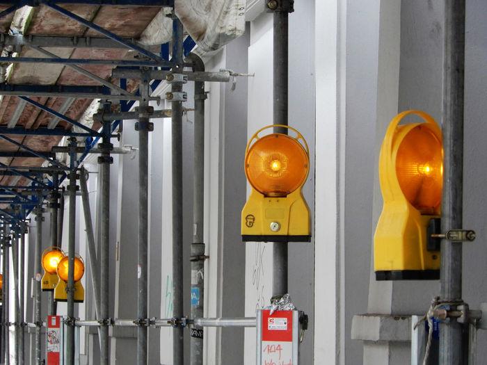 Yellow lanterns hanging in factory