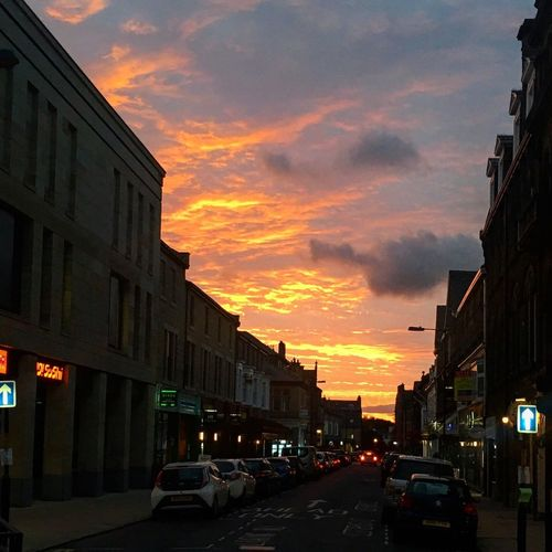 Sunset Architecture Car Building Exterior Built Structure City Cloud - Sky Orange Color Sky Dramatic Sky Outdoors City Street Street Transportation Land Vehicle Travel Destinations No People Cityscape Harrogate Fire Colour Your Horizn Adventures In The City HUAWEI Photo Award: After Dark Capture Tomorrow