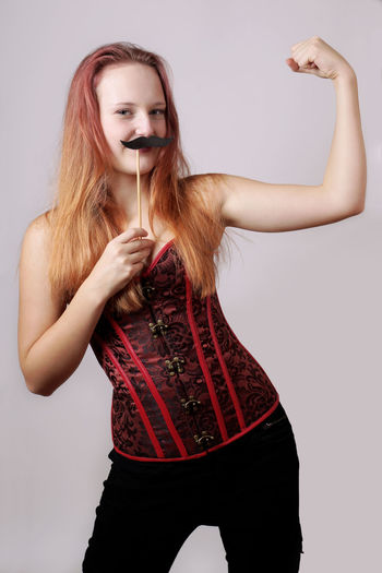 Biceps Bizarre Costume Disguise Fake Mustache Flexing Muscles Funny Gender Girl Looking At Camera Mustache One Person People Portrait Role Play Strong Woman Woman Young Adult Young Woman