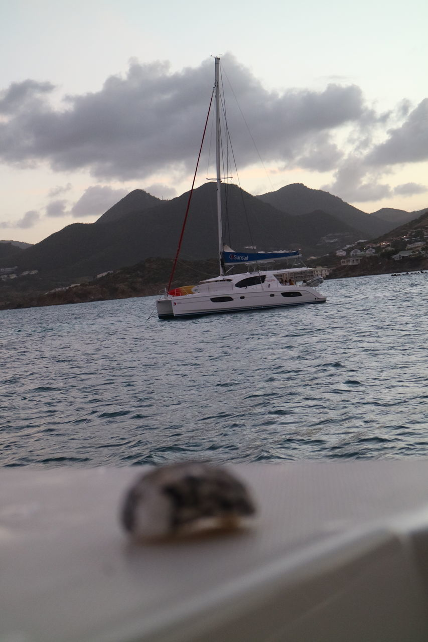 water, transportation, nautical vessel, mode of transportation, mountain, sky, cloud - sky, nature, scenics - nature, sailboat, sea, beauty in nature, tranquil scene, mountain range, no people, tranquility, day, mast, outdoors