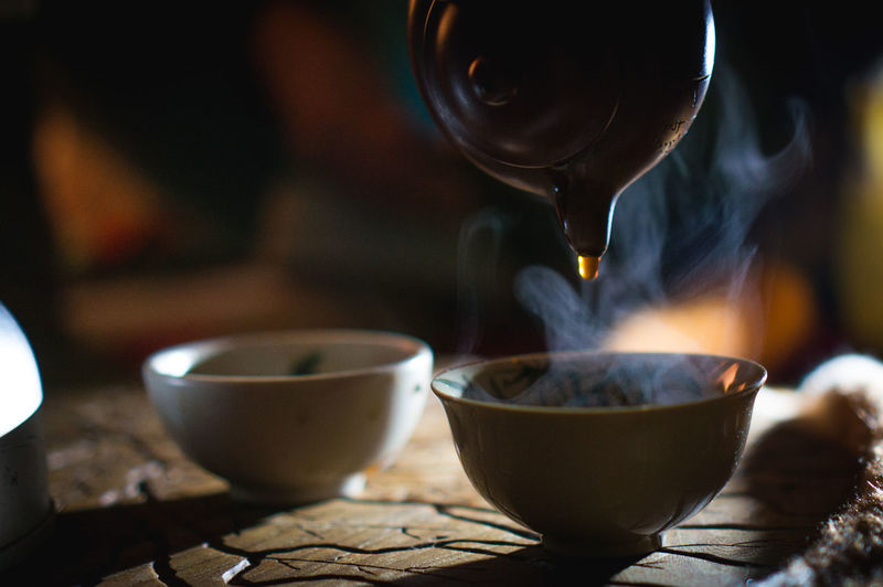Close-Up Of Herbal Tea Being Poured In Cup