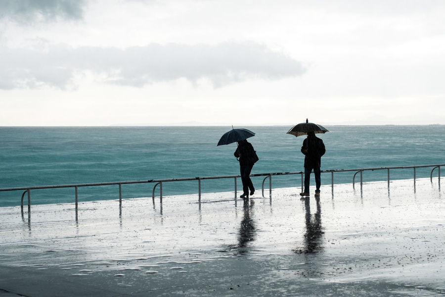Rainy day Blue Coast Cyan Footpath Reflection France Horizon Over Water Nice Night People Rain Rainy Day Rainy Days Real People Reflection Sea And Sky Seashore Shower Silhouettes Storm Stormy Weather Two People Umbrela Umbrelas Waterfront Wet