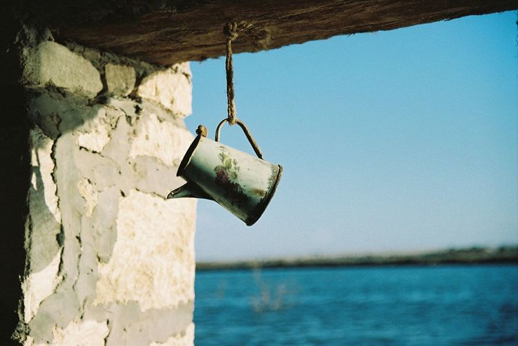 https://www.instagram.com/mariamberodze/ Sea Water Nature Old Hanging Sky Blue Sunlight Day Film Outdoors Weathered Rope Rusty Clear Sky Metal Close-up Padlock No People Focus On Foreground