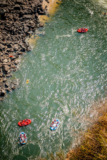 High angle view of inflatable boats on river