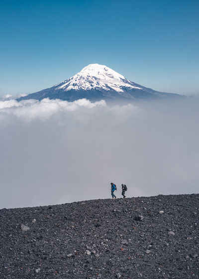 Walking around the crater of the volcano to get up to the summit. Travel Travel Destinations South America Latin America Crater Volcano Mountain Range Remote Adventure Non-urban Scene Nature Outdoors Day Tranquil Scene Tungurahua Togetherness Two People Real People Volcanic Landscape Snowcapped Mountain Leisure Activity Mountain Peak Hiking Climbing Cold Temperature The Traveler - 2019 EyeEm Awards The Great Outdoors - 2019 EyeEm Awards