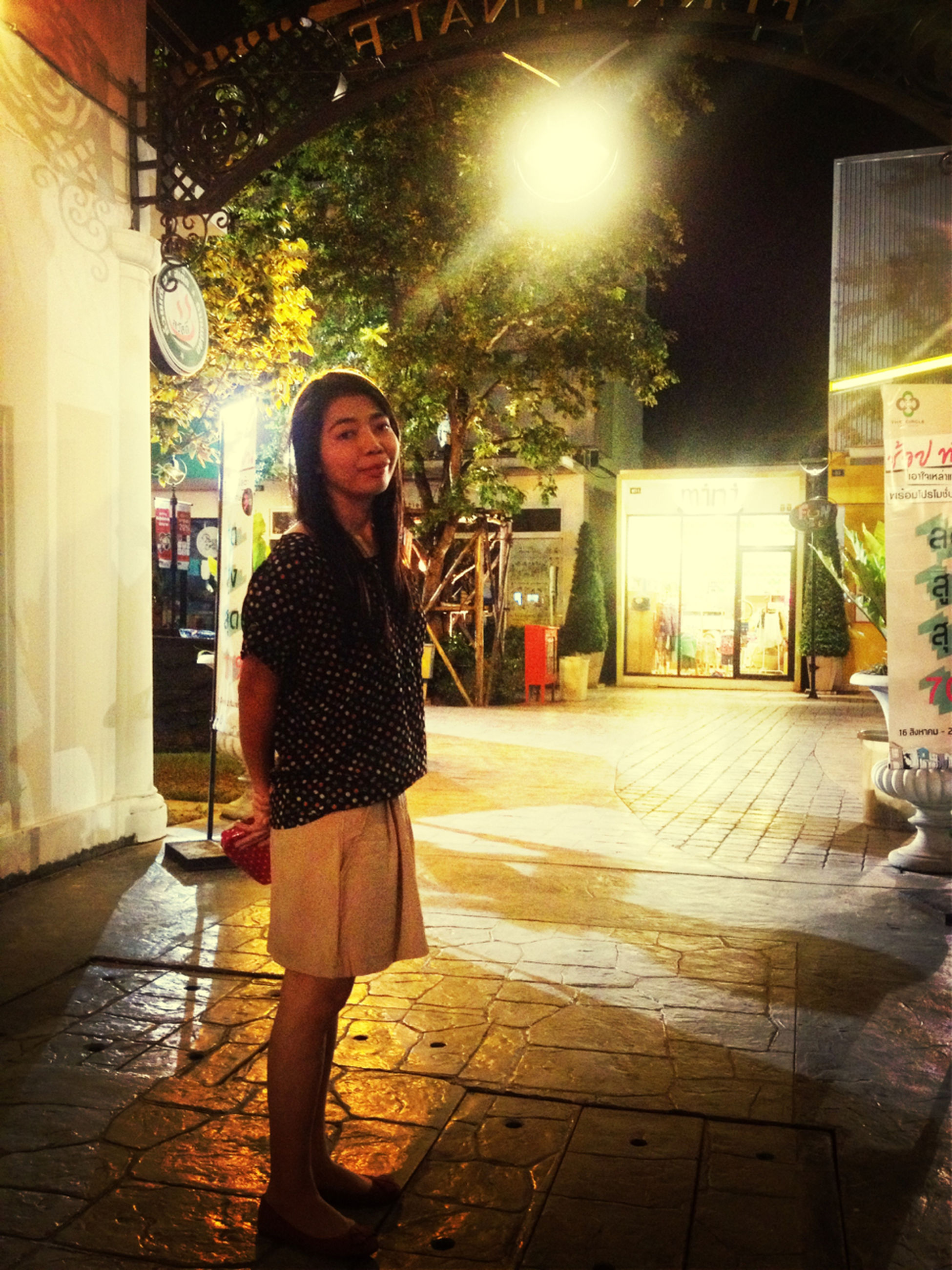 lifestyles, casual clothing, standing, full length, young adult, front view, looking at camera, building exterior, architecture, built structure, portrait, person, leisure activity, night, young women, illuminated, three quarter length
