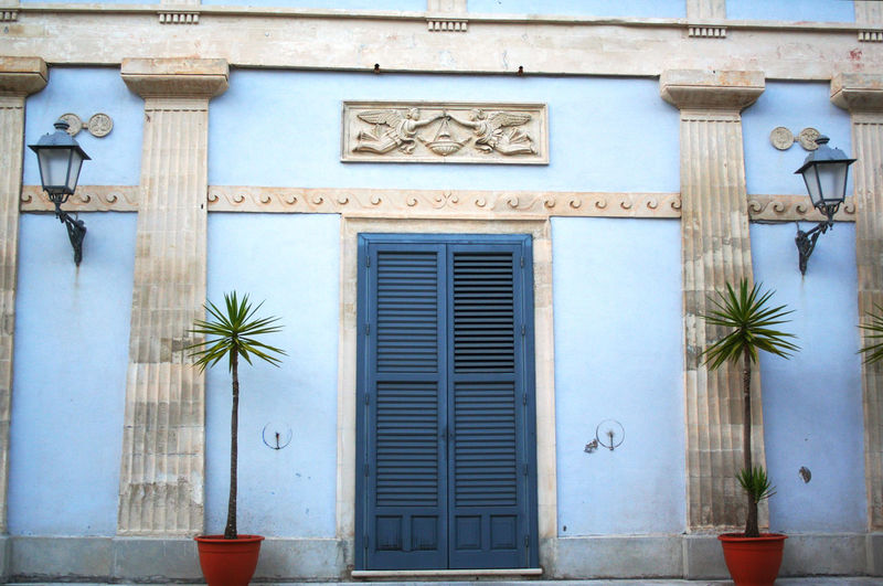 Building Exterior Architecture Built Structure Closed Door Window Entrance Building No People Day Outdoors Blue Wall - Building Feature Façade Residential District City Shutter House Palm Tree Low Angle View Neo Classical Architechture Ragusa Ibla Sicily