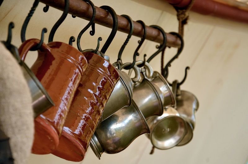 Silverware  Tankards Cup Earthenware Food And Drink Hanging In A Row Kitchen Utensil Metal No People Rack Selective Focus Still Life Tankard
