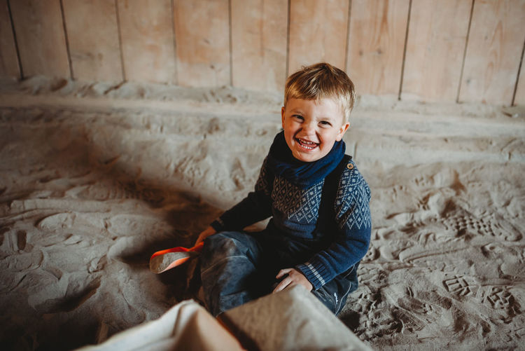 High angle portrait of smiling boy sitting